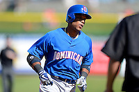 Dominican Republic second baseman Robinson Cano #24 rounds third after hitting a home run during a Spring Training game against the Philadelphia Phillies at Bright House Field on March 5, 2013 in Clearwater, Florida.  The Dominican defeated Philadelphia 15-2.  (Mike Janes/Four Seam Images)