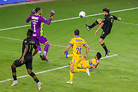 22nd December 2020, Orlando, Florida, USA;  LAFC Diego Rossi shoots and scores his goal during the Concacaf Championship between LAFC and Tigres UANL on December 22, 2020, at Exploria Stadium in Orlando, FL.
