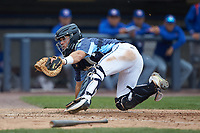 West Michigan Whitecaps catcher Brady Policelli (6) tries to make a tag at home plate during the game against the South Bend Cubs at Fifth Third Ballpark on June 10, 2018 in Comstock Park, Michigan. The Cubs defeated the Whitecaps 5-4.  (Brian Westerholt/Four Seam Images)
