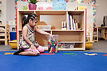 September 14, 2011. Raleigh, NC. . Melissa Valenzuela-Hilario puts away blocks.. Project Enlightenment, a public pre-kindergarten program for at risk children, has been threatened with closure due to state wide budget cuts..