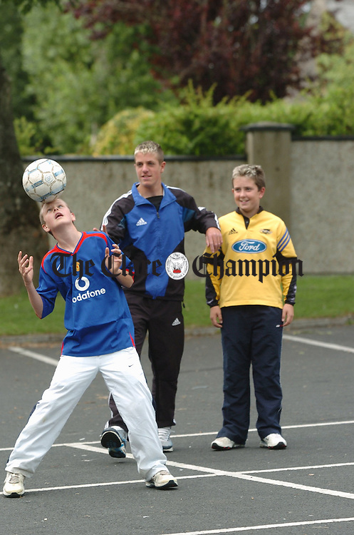 Soccer enthusiast Andrew Phayr displays his skill watched by friendsTrevor Moloney and Barry Mc Namara at Westbury. Photograph by John Kelly.
