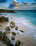 Anguilla, BWI:  Morning clouds over Atlantic Ocean with surf on a pocket beach near Island Harbor, Windward Islands of the Caribbean