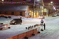 Geir Idar Hjelvik runs down Front Street in Nome on his way to 45th place and the finish line in Nome during the 2017 Iditarod on Friday March 17, 2017.<br /> <br /> Photo by Jeff Schultz/SchultzPhoto.com  (C) 2017  ALL RIGHTS RESERVED