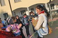 - i nomadi Rom sgomberati dal campo abusivo di via Ripamonti festeggiano il Natale nella casa parrocchiale di Opera....- the Rom nomads evacuated from the unauthorized camp of Ripamonti street celebrate the Christmas in Opera parish house