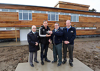 Pictured: Huw Jenkins (2nd L). Tuesday 14 January 2013<br /> Re: Swansea City Football Club chairman Huw Jenkins receives the keys to the new training facility at Fairwood Common, on the outskirts of Swansea, south Wales.