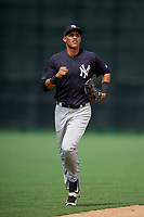 GCL Yankees West center fielder Antonio Arias (12) jogs back to the dugout during the second game of a doubleheader against the GCL Braves on July 30, 2018 at Champion Stadium in Kissimmee, Florida.  GCL Braves defeated GCL Yankees West 5-4.  (Mike Janes/Four Seam Images)