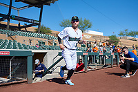 Surprise Saguaros Kyle Isbel (12), of the Kansas City Royals organization, jogs onto the field during player introductions before the Arizona Fall League Championship Game against the Salt River Rafters on October 26, 2019 at Salt River Fields at Talking Stick in Scottsdale, Arizona. The Rafters defeated the Saguaros 5-1. (Zachary Lucy/Four Seam Images)
