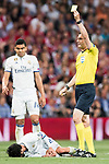 Referee Viktor Kassai shows a yellow card to Xabi Alonso of FC Bayern Munich as Isco Alarcon of Real Madrid lies on the pitch injured during their 2016-17 UEFA Champions League Quarter-finals second leg match between Real Madrid and FC Bayern Munich at the Estadio Santiago Bernabeu on 18 April 2017 in Madrid, Spain. Photo by Diego Gonzalez Souto / Power Sport Images