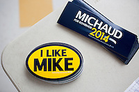 """Bumperstickers and posters reading """"I Like Mike"""" in support of Representative Mike Michaud's (Democrat from Maine's Second Congressional District) campaign for governor lay on a table at the Portland Democratic City Committee town caucus in the East End School cafeteria in Portland, Maine, USA, on March 3, 2014. Michaud is running for governor in 2014. The town caucus had speeches from various other local candidates and also served to choose delegates for the 2014 Maine State Democratic Caucus."""