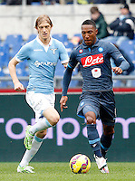 Calcio, Serie A: Lazio vs Napoli. Roma, stadio Olimpico, 18 gennaio 2015.<br /> Napoli's Jonathan De Guzman is chased by Lazio's Dusan Basta, left, during the Italian Serie A football match between Lazio and Napoli at Rome's Olympic stadium, 18 January 2015.<br /> UPDATE IMAGES PRESS/Riccardo De Luca