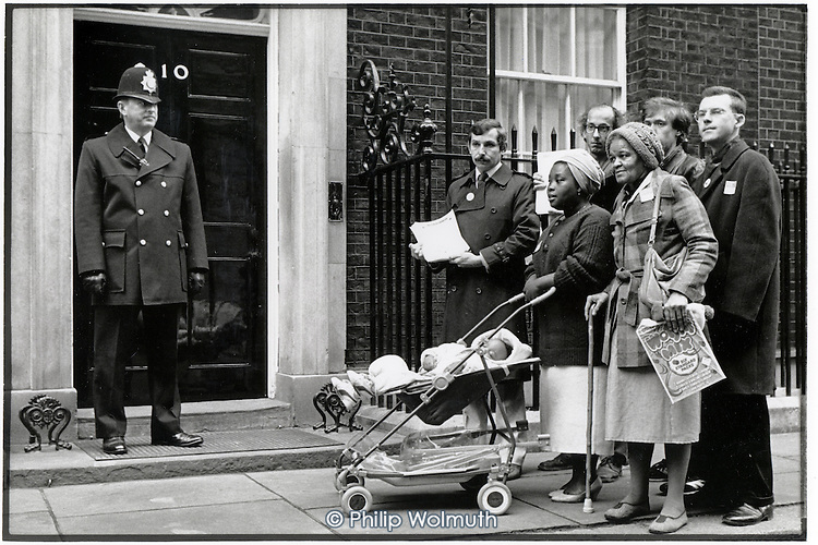Dora Boatemah and other tenant representatives from estates which the government plans to hand over to Housing Action Trusts (HATs) hand in a petition of protest at 10 Downing Street.