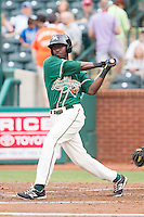 Javier Lopez (16) of the Greensboro Grasshoppers follows through on his swing against the Hagerstown Suns at NewBridge Bank Park on May 20, 2014 in Greensboro, North Carolina.  The Grasshoppers defeated the Suns 5-4. (Brian Westerholt/Four Seam Images)