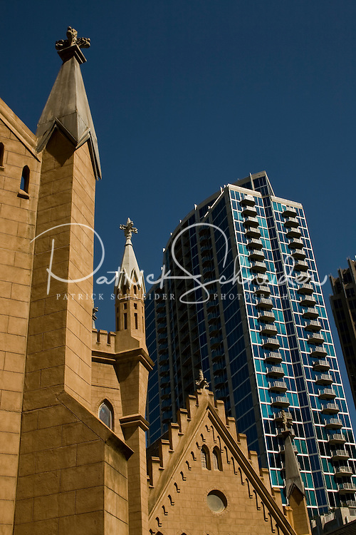 Office buildings and a church are shown in uptown Charlotte, NC.