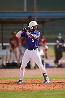 Fran Abdiel Montanez Rosario (9) bats during the Perfect Game National Underclass East Showcase on January 23, 2021 at Baseball City in St. Petersburg, Florida.  (Mike Janes/Four Seam Images)