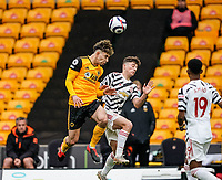 23rd May 2021; Molineux Stadium, Wolverhampton, West Midlands, England; English Premier League Football, Wolverhampton Wanderers versus Manchester United; Rayan Aït-Nouri of Wolverhampton Wanderers heads the ball forward in midfield