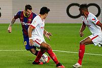 4th October 2020; Camp Nou, Barcelona, Catalonia, Spain; La Liga Football, Barcelona versus Sevilla; Leo Messi of Barcelona confused two Sevilla defenders as he breaks into the box
