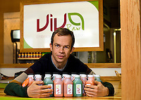 Viva Raw is a vendor at 7th Street Public Market in Uptown Charlotte, North Carolina. Building upon the success of Charlotte's Center City Green Market, the Seventh Street Public Market opened in 2012 to be a year-round market serving and celebrating local food artisans, entrepreneurs and local and regional farmers. Image is part of a series of photos taken of the Center City attraction.