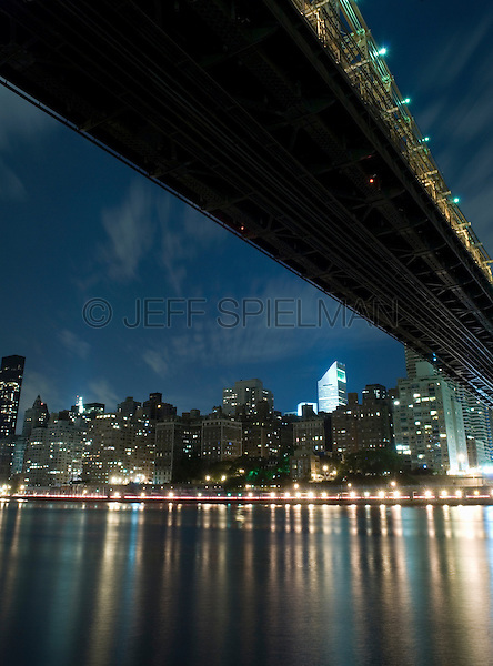 AVAILABLE FROM JEFF AS A FINE ART PRINT.<br /> <br /> AVAILABLE FROM PLAINPICTURE.COM FOR COMMERCIAL AND EDITORIAL LICENSING.  Please go to www.plainpicture.com and search for image # p5690173.<br /> <br /> Queensboro Bridge, East River and Midtown Manhattan Skyline at Night, New York City, New York State, USA