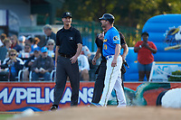 Umpire Mark Bass walks away from Myrtle Beach Pelicans manager Steve Lerud (39) while he argues during the game against the Winston-Salem Dash at TicketReturn.com Field on May 16, 2019 in Myrtle Beach, South Carolina. The Dash defeated the Pelicans 6-0. (Brian Westerholt/Four Seam Images)
