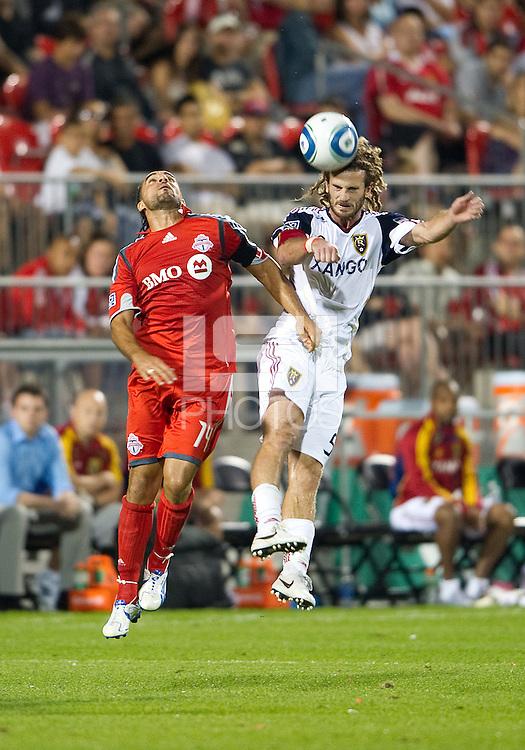 28 August 2010: Real Salt Lake midfielder Kyle Beckerman #5 and Toronto FC forward Dwayne De Rosario #14 in action during a game between Real Salt Lake and Toronto FC at BMO Field in Toronto..The game ended in a 0-0 draw..