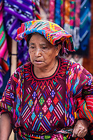 Chichicastenango, Guatemala.  Quiche (Kiche, K'iche') Woman in the Market Wearing Traditional Clothing.