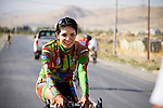 SULAIMANIYAH, IRAQ: Cyclist Nyan Yassin warms down after finishing racing on the last day of racing.<br /> <br /> Nyan Yassin, 24, is a professional competitive cyclist in Sulaimaniyah in the semi-autonomous region of Iraqi Kurdistan.  She is the captain of an all-female club called Newroz Club, which is the only cycling club for women in Sulaimaniyah, although there are other clubs around Iraq.  She trains and competes on roads that are badly surfaced and busy with traffic.<br /> <br /> Nyan was the first woman to start cycling in Sulaimaniyah.  She was always competitive and after trying her hand at different sports she settled on cycling.  She is now the top female cyclist in Iraq.  Her nickname is MigMig after the noise made by the cartoon character Roadrunner.<br /> <br /> Despite being clearly talented at her sport Nyan knows that in a couple of years she will have to get married and then abandon it as, in the traditional society that Kurdistan is, being a wife and a competitive sportswoman at the same time is not an option.<br /> <br /> Photo by Gona Hassan/Metrography