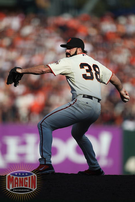 SAN FRANCISCO - OCTOBER 19:  Brian Wilson of the San Francisco Giants pitches against the Philadelphia Phillies during Game 3 of the NLCS at AT&T Park on October 19, 2010 in San Francisco, California. (Photo by Brad Mangin)