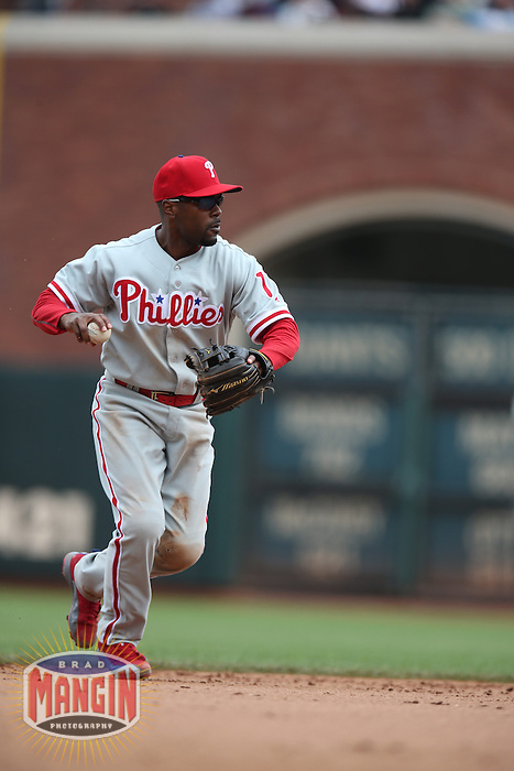 SAN FRANCISCO, CA - MAY 8:  Jimmy Rollins #11 of the Philadelphia Phillies makes a play at shortstop against the San Francisco Giants during the game at AT&T Park on Wednesday, May 8, 2013 in San Francisco, California. Photo by Brad Mangin
