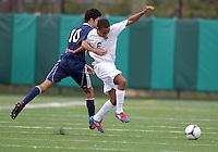 HYATTSVILLE, MD - OCTOBER 26, 2012:  Jonathan Ware (6) of DeMatha Catholic High School is fouled by Arjan Ganji (10) of St. Albans during a match at Heurich Field in Hyattsville, MD. on October 26. DeMatha won 2-0.