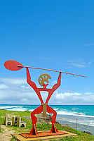 A metal representation of a Hawaiian warrior wearing a malo and holding a canoe paddle, Turtle Bay, O'ahu.