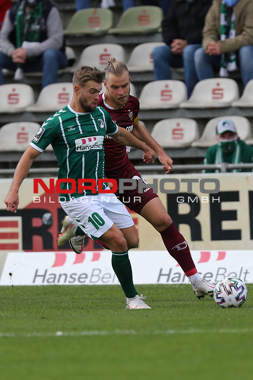 17.10.2020, Dietmar-Scholze-Stadion an der Lohmuehle, Luebeck, GER, 3. Liga, VfB Luebeck vs SG Dynamo Dresden <br /> <br /> im Bild / picture shows <br /> Yannick Deichmann (VfB Luebeck) im Zweikampf gegen Sebastian Mai (SG Dynamo Dresden) <br /> <br /> DFB REGULATIONS PROHIBIT ANY USE OF PHOTOGRAPHS AS IMAGE SEQUENCES AND/OR QUASI-VIDEO.<br /> <br /> Foto © nordphoto / Tauchnitz