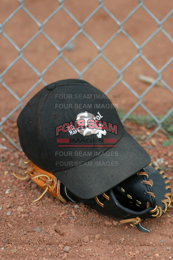 August 23, 2005:  Glove and hat of the Bristol White Sox during a game at Devault Memorial Stadium in Bristol, VA.  Bristol is the Appalachian League Rookie affiliate of the Chicago White Sox.  Photo by:  Mike Janes/Four Seam Images