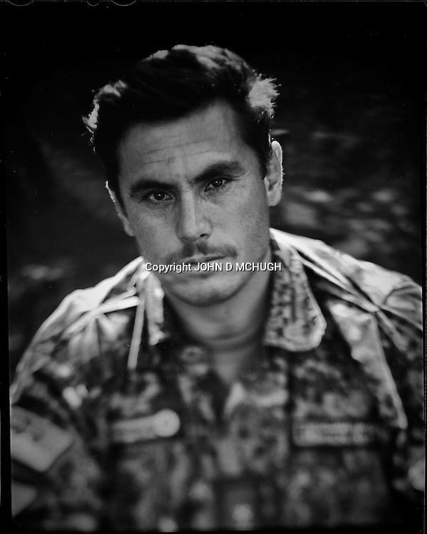 """Lieutenant Jan Aqa, Afghan National Army, is seen in Kabul 30 August 2012. This portrait was shot on a 5x4 Linhof Technika IV, circa 1959, and a Schneider Kreuznach 270mm lens, circa 1952, with front tilt, and is part of a series entitled """"Putting an Afghan face on the war."""" (John D McHugh)"""