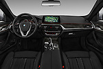 Stock photo of straight dashboard view of a 2018 BMW 5 Series Sport 4 Door Sedan