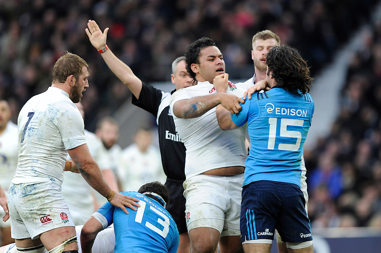 Billy Vunipola of England and Luke McLean of Italy have a disagreement during the RBS 6 Nations match between England and Italy at Twickenham Stadium on Saturday 14th February 2015 (Photo by Rob Munro)