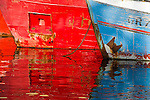 Red and blue boat reflections in the harbour of Nuuk, Greenland.