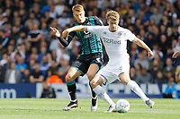 LEEDS, ENGLAND - AUGUST 31: (L-R) Patrick Bamford of Leeds United (R) challenged by Jay Fulton of Swansea City (L) during the Sky Bet Championship match between Leeds United and Swansea City at Elland Road on August 31, 2019 in Leeds, England. (Photo by Athena Pictures/Getty Images)