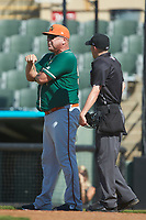 Greensboro Grasshoppers manager Todd Pratt (55) discusses a call with home plate umpire Matt Baldwin during the game against the Kannapolis Intimidators at Kannapolis Intimidators Stadium on August 5, 2018 in Kannapolis, North Carolina. The Intimidators defeated the Grasshoppers 9-0 in game two of a double-header.  (Brian Westerholt/Four Seam Images)