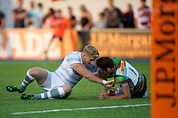 20130803 Copyright onEdition 2013 ©<br />Free for editorial use image, please credit: onEdition.<br /><br />Tom Rees of London Irish 7s (left) gets to grips with Ollie Lindsay-Hague of Harlequins 7s during the J.P. Morgan Asset Management Premiership Rugby 7s Series.<br /><br />The J.P. Morgan Asset Management Premiership Rugby 7s Series kicks off for the fourth season on Thursday 1st August with Pool A at Kingsholm, Gloucester with Pool B being played at Franklin's Gardens, Northampton on Friday 2nd August, Pool C at Allianz Park, Saracens home ground, on Saturday 3rd August and the Final being played at The Recreation Ground, Bath on Friday 9th August. The innovative tournament, which involves all 12 Premiership Rugby clubs, offers a fantastic platform for some of the country's finest young athletes to be exposed to the excitement, pressures and skills required to compete at an elite level.<br /><br />The 12 Premiership Rugby clubs are divided into three groups for the tournament, with the winner and runner up of each regional event going through to the Final. There are six games each evening, with each match consisting of two 7 minute halves with a 2 minute break at half time.<br /><br />For additional images please go to: http://www.w-w-i.com/jp_morgan_premiership_sevens/<br /><br />For press contacts contact: Beth Begg at brandRapport on D: +44 (0)20 7932 5813 M: +44 (0)7900 88231 E: BBegg@brand-rapport.com<br /><br />If you require a higher resolution image or you have any other onEdition photographic enquiries, please contact onEdition on 0845 900 2 900 or email info@onEdition.com<br />This image is copyright the onEdition 2013©.<br /><br />This image has been supplied by onEdition and must be credited onEdition. The author is asserting his full Moral rights in relation to the publication of this image. Rights for onward transmission of any image or file is not granted or implied. Changing or deleting Copyright information is illegal as specified in the Copyr