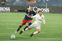 FOXBOROUGH, MA - NOVEMBER 1: Yamil Asad #11 of DC United and Teal Bunbury #10 of New England Revolution collide during a tackle during a game between D.C. United and New England Revolution at Gillette Stadium on November 1, 2020 in Foxborough, Massachusetts.