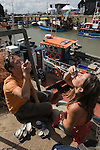 Whitstable Oyster Festival, Kent England 2007. Zoe Goss and Tim Sydenham down from London enjoying the festival.