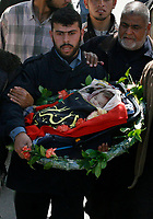 """A man carries the body of a newborn Palestinian baby, whom Palestinian medics said was killed by the Israeli forces gunfire late on Tuesday, in the central Gaza Strip March 5, 2008. Medical workers said the baby was killed and eight other people wounded by gunfire in the clash. The Israeli army said the military operation in central Gaza Strip was targeted at Palestinian militants.""""photo by Fday Adwan"""""""
