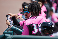 Charlotte Knights hitting coach Chris Johnson (23) talks to Brian Goodwin (36) during the game against the Gwinnett Stripers at Truist Field on May 9, 2021 in Charlotte, North Carolina. (Brian Westerholt/Four Seam Images)