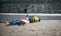 HOT WEATHER WALES Aberystwyth, Ceredigion, West Wales. UK Weather Wednesday  8th June 2016: With yellow warnings for rain across swathes of England the sun comes out at lunchtime with temperatures reaching 19 degrees celsius after a dull morning. A man enjoys a can of beer whilst sunbathing.