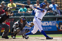 Round Rock shortstop Jurickson Profar (10) follows through on his swing against the Nashville Sounds in the Pacific Coast League baseball game on May 5, 2013 at the Dell Diamond in Round Rock, Texas. Round Rock defeated Nashville 5-1. (Andrew Woolley/Four Seam Images).