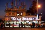 MUMBAI, INDIA - SEPTEMBER 27, 2010: The Haji Ali Juice Centre at the mainland entrance to the tomb of Haji Ali, a Muslim famous shrine set off the coast of Mahalakshmi in Mumbai.The Taj Mahal Palace and Tower Hotel in Mumbai has re-opened after the terror attacks of 2008 destroyed much of the heritage wing. The wing has been renovated and the hotel is once again the shining jewel of Mumbai. pic Graham Crouch