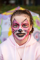Cute Girl with Pink Cat Face Paint, Arts A Glow Festival 2017, Dottie Harper Park, Burien, WA, USA.