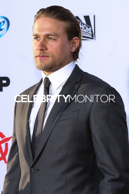 """[(FILE) Actor Charlie Hunnam has been cast as the lead actor in """"Fifty Shades of Grey"""" (2014 Film) to play character Christian Grey. Focus Features and Universal Pictures announced Monday, Sept. 2, 2013 that Hunnam will play the 27-year-old billionaire Christian Grey in the big-screen adaptation of E L James' """"Fifty Shades of Grey"""". Dakota Johnson will play the college student he captivates, Anastasia Steele.] HOLLYWOOD, CA - SEPTEMBER 07: Actor Charlie Hunnam at the Premiere Of FX's """"Sons Of Anarchy"""" Season 6 held at the Dolby Theatre on September 7, 2013 in Hollywood, California. (Photo by Rudy Torres/Celebrity Monitor)"""