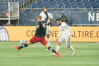 FOXBOROUGH, MA - NOVEMBER 1: Adam Buksa #9 of New England Revolution tries to intercept a pass from Junior Moreno #5 of DC United during a game between D.C. United and New England Revolution at Gillette Stadium on November 1, 2020 in Foxborough, Massachusetts.