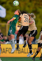 St. Louis Athletica midfielder Lori Chalupny (17) goes up for a header against FC Gold Pride midfielder Formiga (31) and Gold Pride midfielder Leslie Osborne (10) during a WPS match at Korte Stadium, in St. Louis, MO, May 9 2009. St. Louis Athletica won the match 1-0.